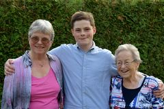 Teenage boy and his grandmothers stock images