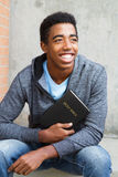 Teenage boy holding a Bible Royalty Free Stock Image