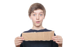 Teenage boy holding a brown piece of cardboard Royalty Free Stock Images