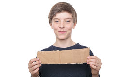 Teenage boy holding a brown piece of cardboard Royalty Free Stock Image