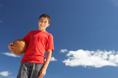 Teenage boy holding football Stock Photography