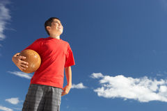 Teenage boy holding football Royalty Free Stock Image