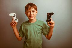 Teenage boy holding a game joystick  Stock Photo