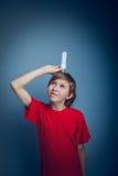 Teenage boy holding a light bulb European Royalty Free Stock Image