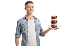Teenage boy holding a plate of donuts Royalty Free Stock Image