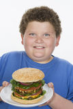 Teenage Boy Holding Plate Of Hamburger Stock Image