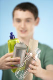 Teenage Boy Holding Recycling Royalty Free Stock Photos