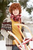 Teenage Boy Holding Sledge In Snow Royalty Free Stock Photography