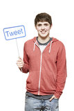 Teenage boy holding a social media sign smiling Stock Images
