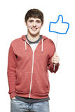 Teenage boy holding a social media sign smiling Stock Photo