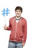Teenage boy holding a social media sign smiling stock photos