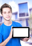 Teenage boy holding a tablet Royalty Free Stock Images