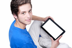 Teenage boy holding a tablet Stock Images