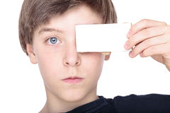 Teenage boy holding a white piece of cardboard Stock Photography