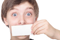 Teenage boy holding a white piece of cardboard Stock Image