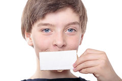 Teenage boy holding a white piece of cardboard Stock Images