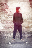 Teenage boy with hoodie standing on a Stock Photography
