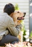 Teenage boy hugging pet dog stock photos