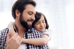 Teenage boy hugs adult father. Good relationship between father and son stock images