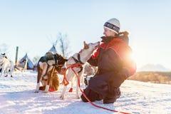 Teenage boy with husky dog. Teenage boy having a cuddle with husky sled dog in Northern Norway Royalty Free Stock Photos