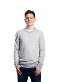 Teenage boy in jeans and sweater. Studio shot, isolated. Stock Images
