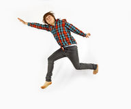 Teenage Boy Jumping In The Air Royalty Free Stock Photos