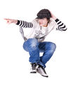 Teenage boy jumping and dancing Locking dance. Teenage boy jumping and dancing Locking or Hip-hop dance over isolated background royalty free stock images