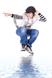 Teenage boy jumping and dancing Locking or Hip-hop. Dance over isolated background stock photography