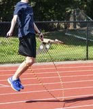 Runner jumping rope on a track royalty free stock photo