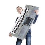 Teenage boy and keyboard in studio Royalty Free Stock Photography