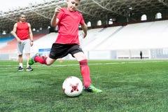Teenage Boy Kicking Ball stock image