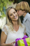 Teenage Boy Kissing Mother Stock Photo