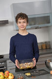 Teenage Boy in the kitchen Stock Image