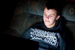 Teenage boy with laptop royalty free stock photo