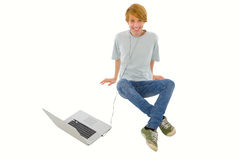 Teenage boy with laptop Stock Images