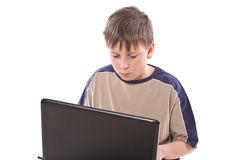 Teenage boy with a laptop Stock Photo