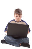 Teenage boy with a laptop stock image