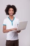 Teenage boy with laptop. Royalty Free Stock Photos
