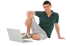 Teenage boy with laptop Stock Image