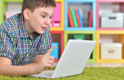Teenage boy with a laptop Stock Images