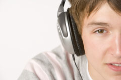 Teenage Boy Listening To Music On Headphones Stock Photography