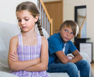Teenage boy and  little girl quarrelling at home Stock Photos