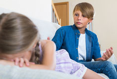 Teenage boy and  little girl quarrelling at home Royalty Free Stock Image