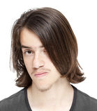 Teenage boy with long  dark hair Stock Images
