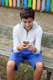 Teenage boy looking the mobile Stock Image