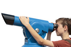 Teenage boy looking through a sightseeing monocular Stock Photos