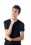 Teenage boy looking up thinking Royalty Free Stock Photo