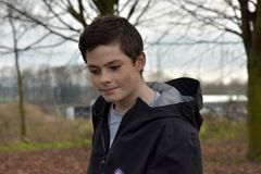 Teenage boy lost in thought. Melancholic  looking  teenager boy  with  big problems feeling alone Royalty Free Stock Photos