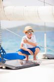 Teenage boy at luxury yacht Royalty Free Stock Image