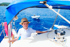 Teenage boy at luxury yacht Royalty Free Stock Images